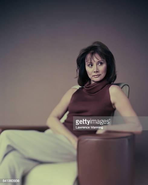 Woman Sitting in Armchair