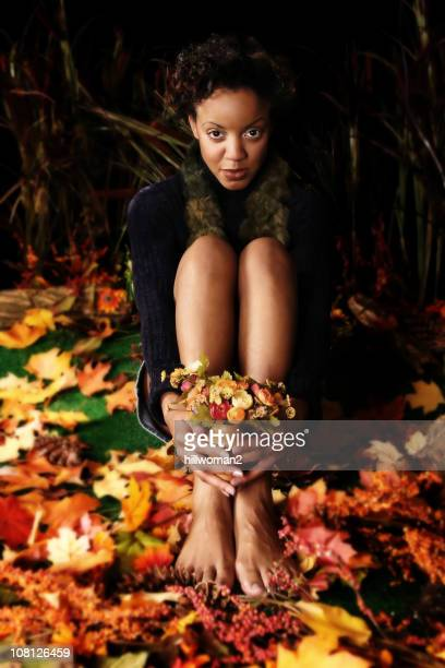Woman Sitting in Autumn Leaves