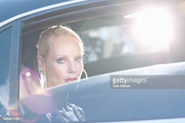 Woman sitting in backseat of car