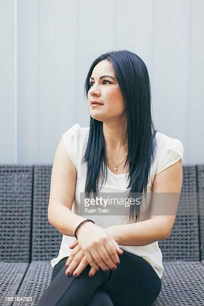 Woman sitting in backyard patio