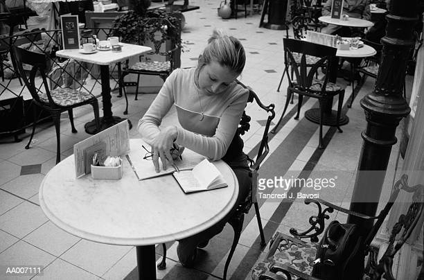 woman sitting in cafe - bavosi stock photos and pictures