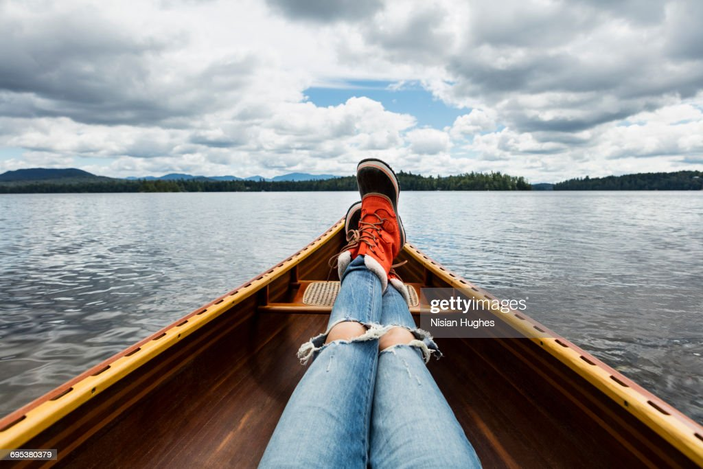 Woman sitting in canoe POV looking out : Stock Photo