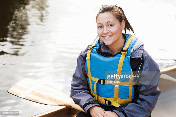 woman sitting in canoe - water sport stock photos and pictures