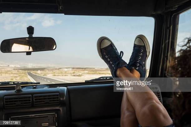 woman sitting in car with feet up on dashboard - cool cars stock pictures, royalty-free photos & images