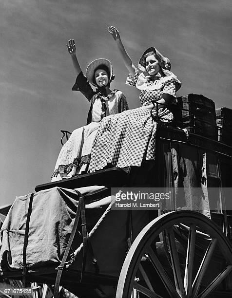 woman sitting in cart and smiling  - {{ contactusnotification.cta }} stockfoto's en -beelden