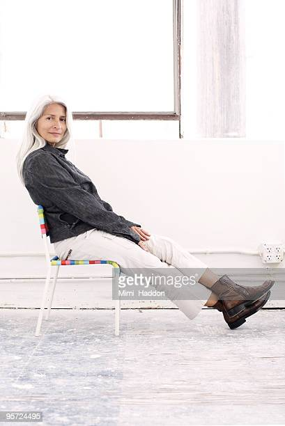Woman sitting in Child's Chair