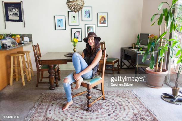 woman sitting in her dining room
