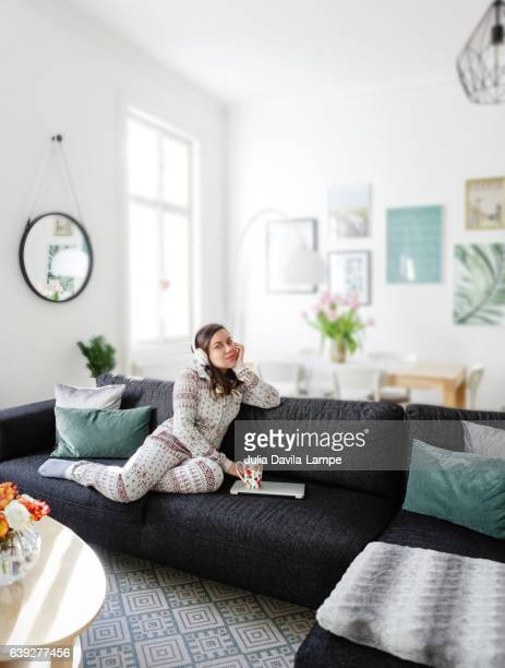 Woman sitting in her living room.
