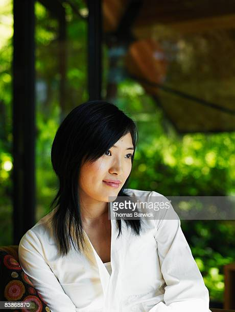 Woman sitting in home in woods