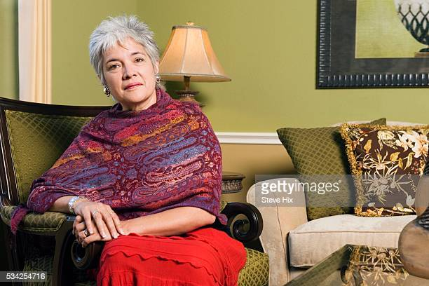 woman sitting in living room - shawl stock pictures, royalty-free photos & images