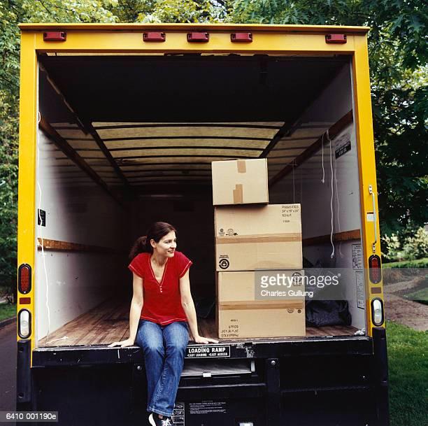 Woman Sitting in Moving Van