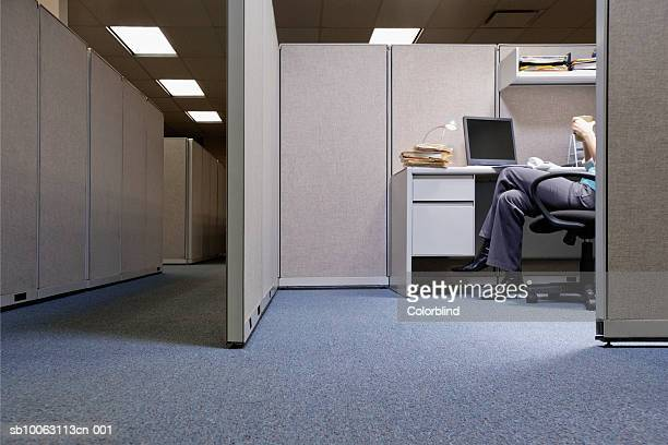 Woman sitting in office, low section
