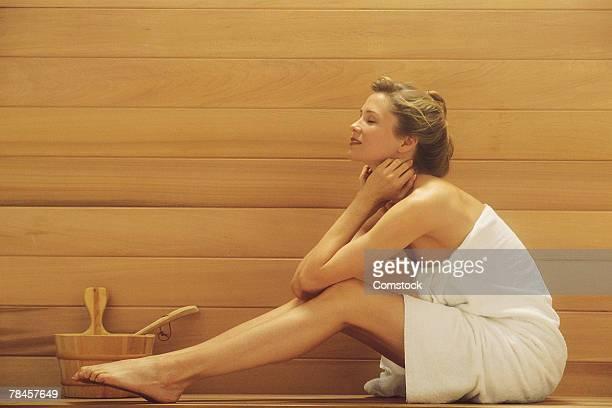 Woman sitting in sauna