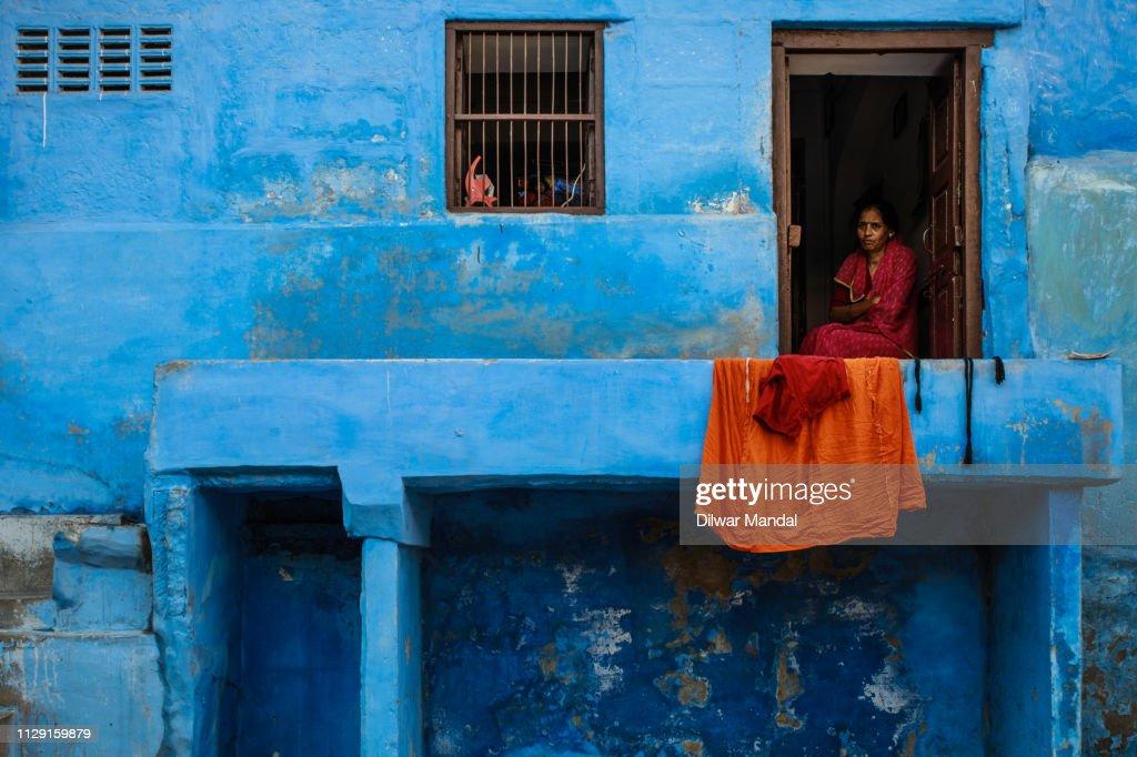 Woman sitting in the door : Stock Photo