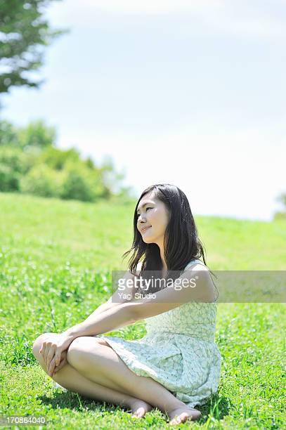 Woman sitting in the nature