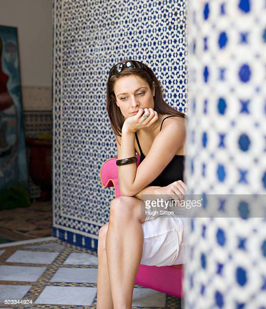 woman sitting in thought - hugh sitton stock pictures, royalty-free photos & images