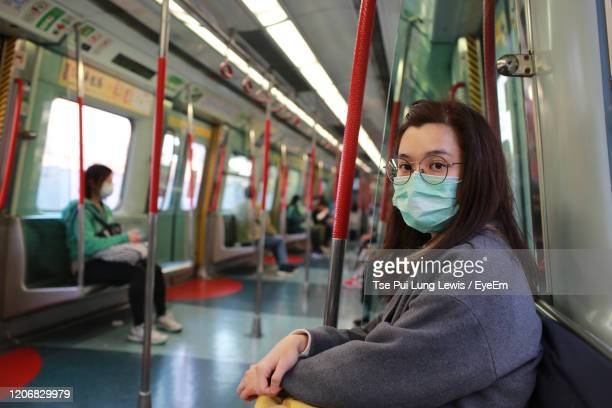 woman sitting in train - china coronavirus stock pictures, royalty-free photos & images