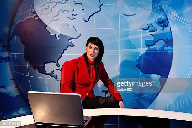 Woman sitting in tv studio