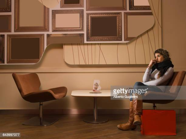 Woman sitting in waiting area
