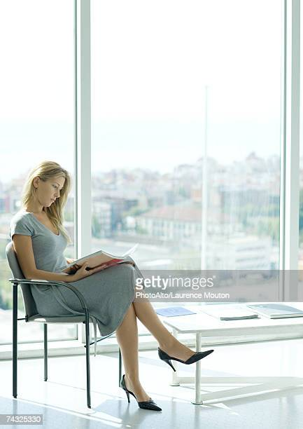 woman sitting in waiting room - one young woman only stock pictures, royalty-free photos & images
