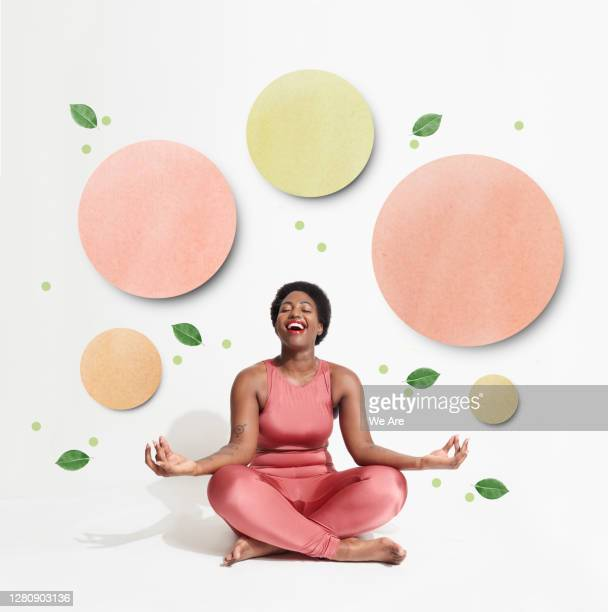 woman sitting in yoga pose - om symbol stock pictures, royalty-free photos & images