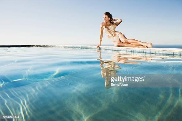 Woman sitting near swimming pool