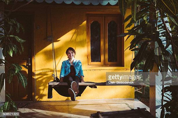 Woman sitting near the house