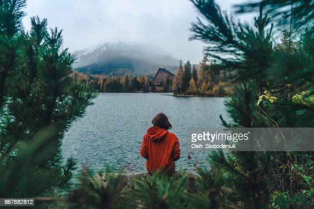 woman sitting   near the lake in  mountains - slovakia stock pictures, royalty-free photos & images