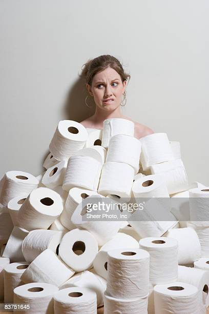woman sitting neck-deep in toilet paper - funny toilet paper imagens e fotografias de stock