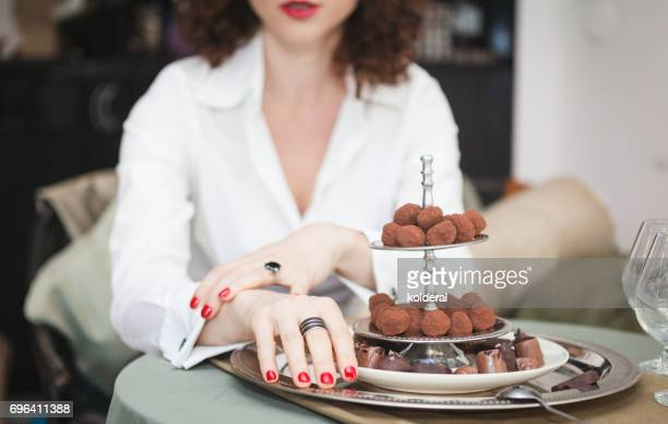 Woman sitting next to chocolate plate