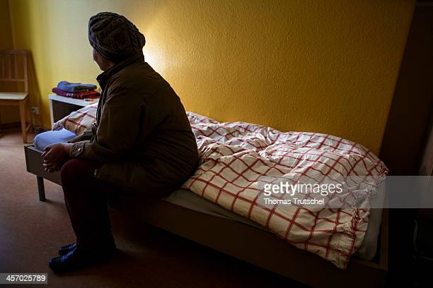 ILLUSTRATION Woman sitting on a bed in an emergency shelter for women in the Tieckstrasse in Berlin Mitte on December 11 in Berlin Germany This...