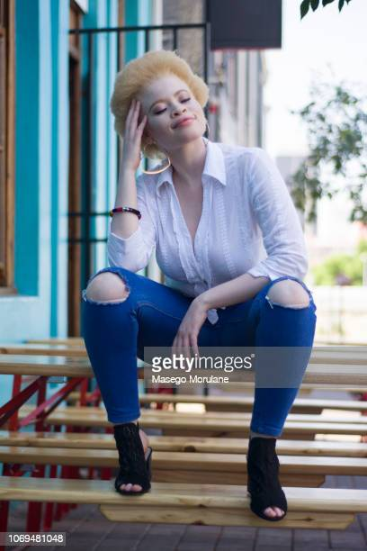 woman sitting on a bench in the city - thick black woman stock photos and pictures