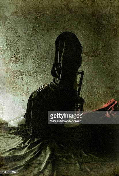 Woman sitting on a chair, Lugansk, Ukraine