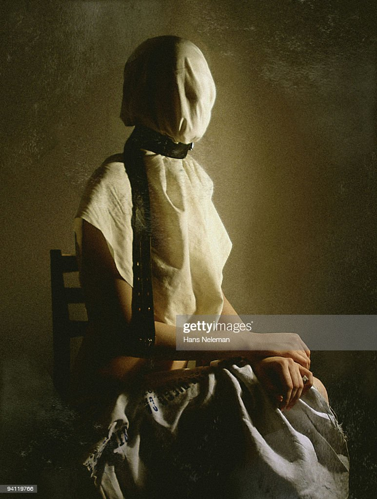 Woman sitting on a chair with obscured face, Lugansk, Ukraine : Stock Photo