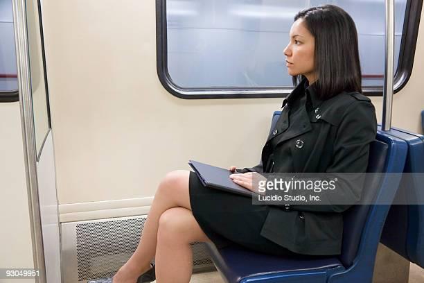 Woman sitting on a commuter train