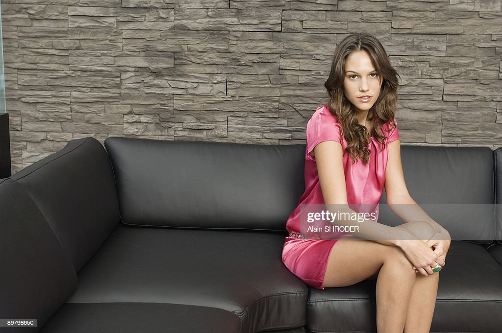 Woman sitting on a couch : Stock Photo