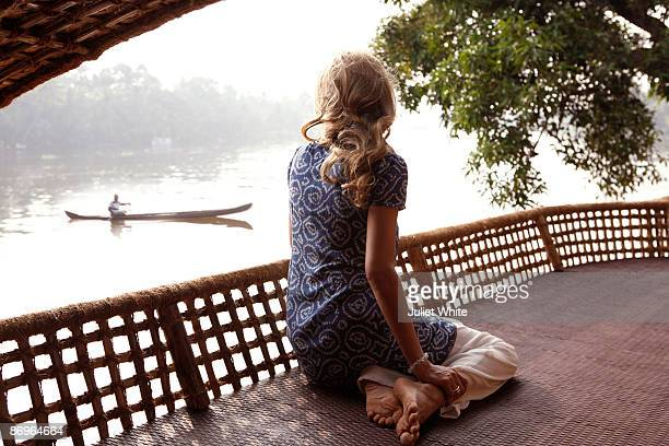 woman sitting on a houseboat, rear view - kerala stock pictures, royalty-free photos & images