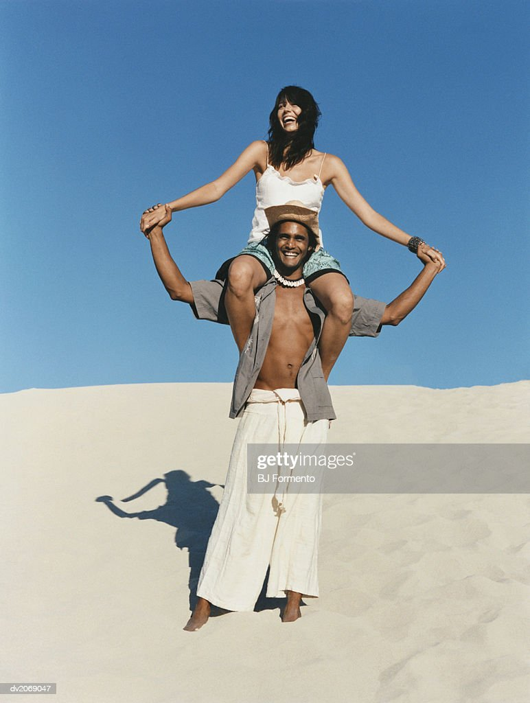 Woman Sitting on a Man's Shoulders : Stock Photo