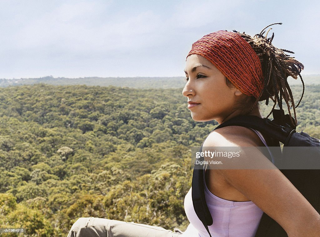 Woman Sitting on a Mountain Top Looking at View : Stock Photo