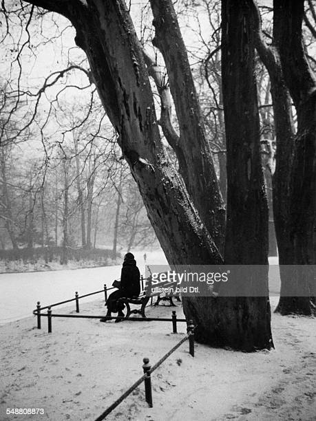 Woman sitting on a park bench beside the sea Neuer See undated Photographer Seidenstuecker Published by 'Uhu' 3/1934 Vintage property of ullstein bild