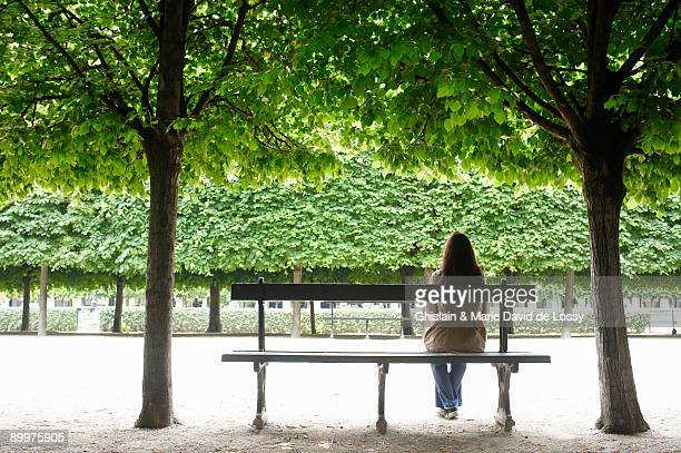 Woman sitting on a public bench