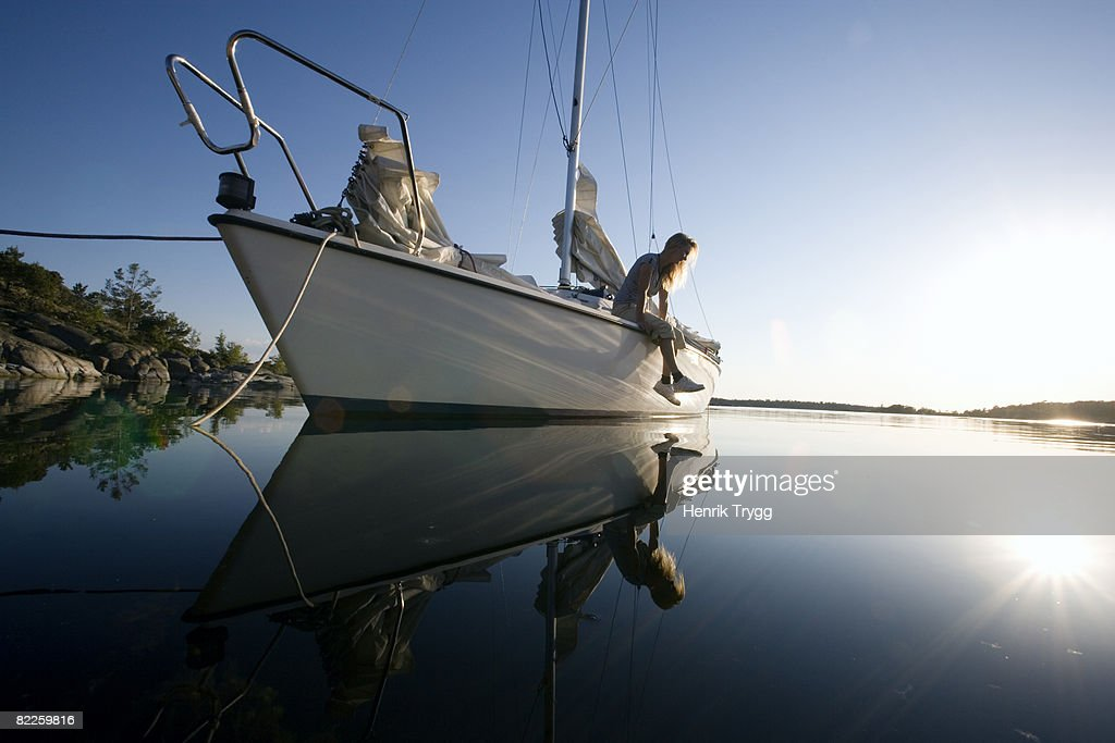 A woman sitting on a sailing-boat Ostergotland Sweden. : Stock Photo