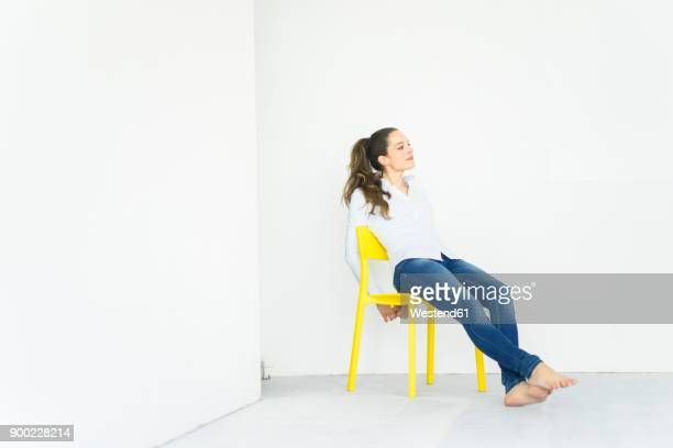 Woman sitting on a yellow chair