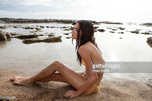 woman sitting on beach - beautiful puerto rican women stock photos and pictures