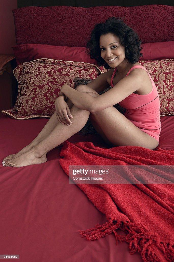 Woman sitting on bed : Foto de stock