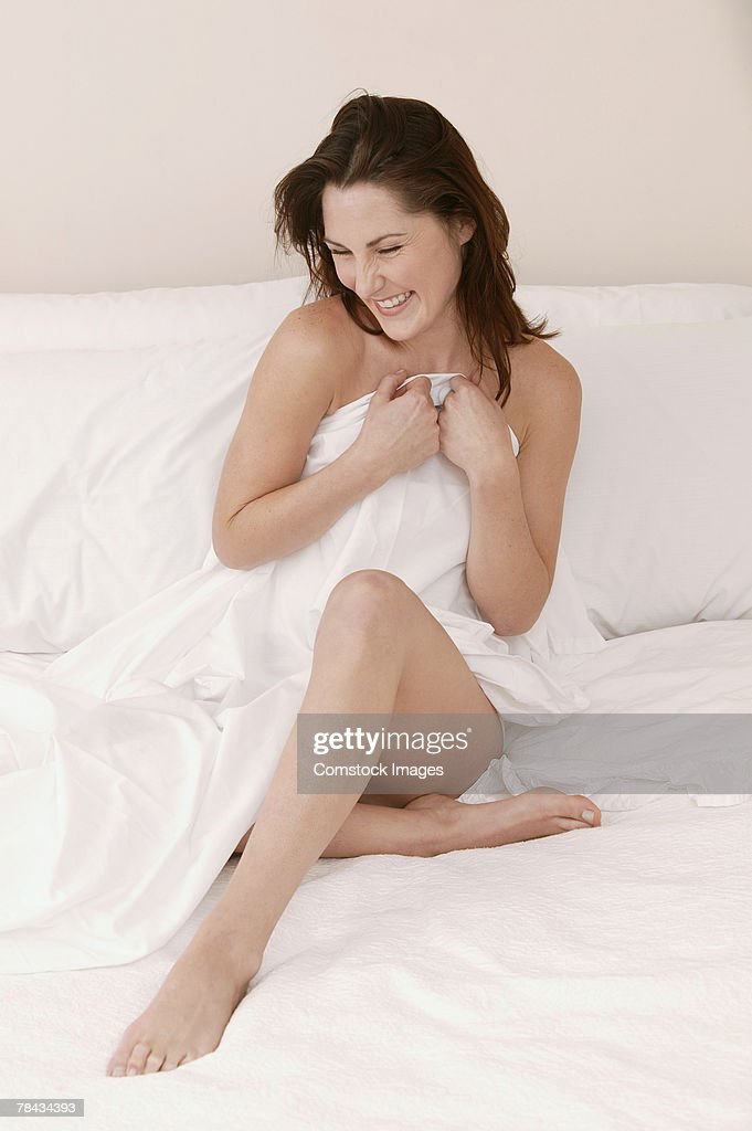 Woman sitting on bed : Foto de stock