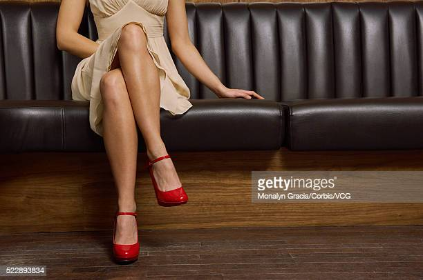 Woman sitting on bench at club