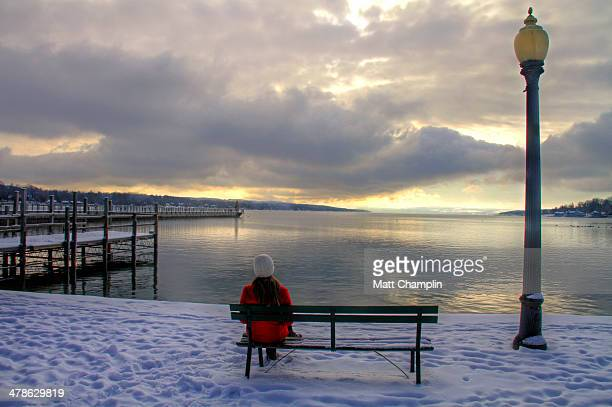 Woman Sitting on Bench on Cold Winter Morning