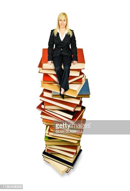 woman sitting on books - knowledge is power stock pictures, royalty-free photos & images