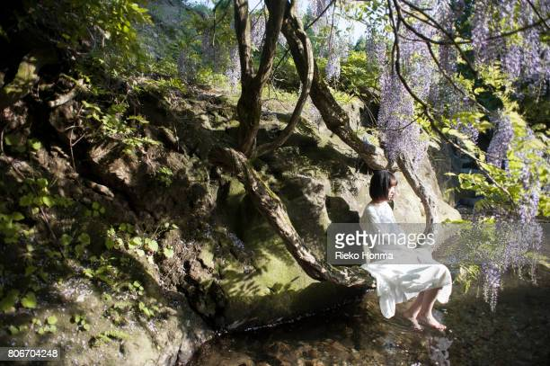 Woman sitting on branch